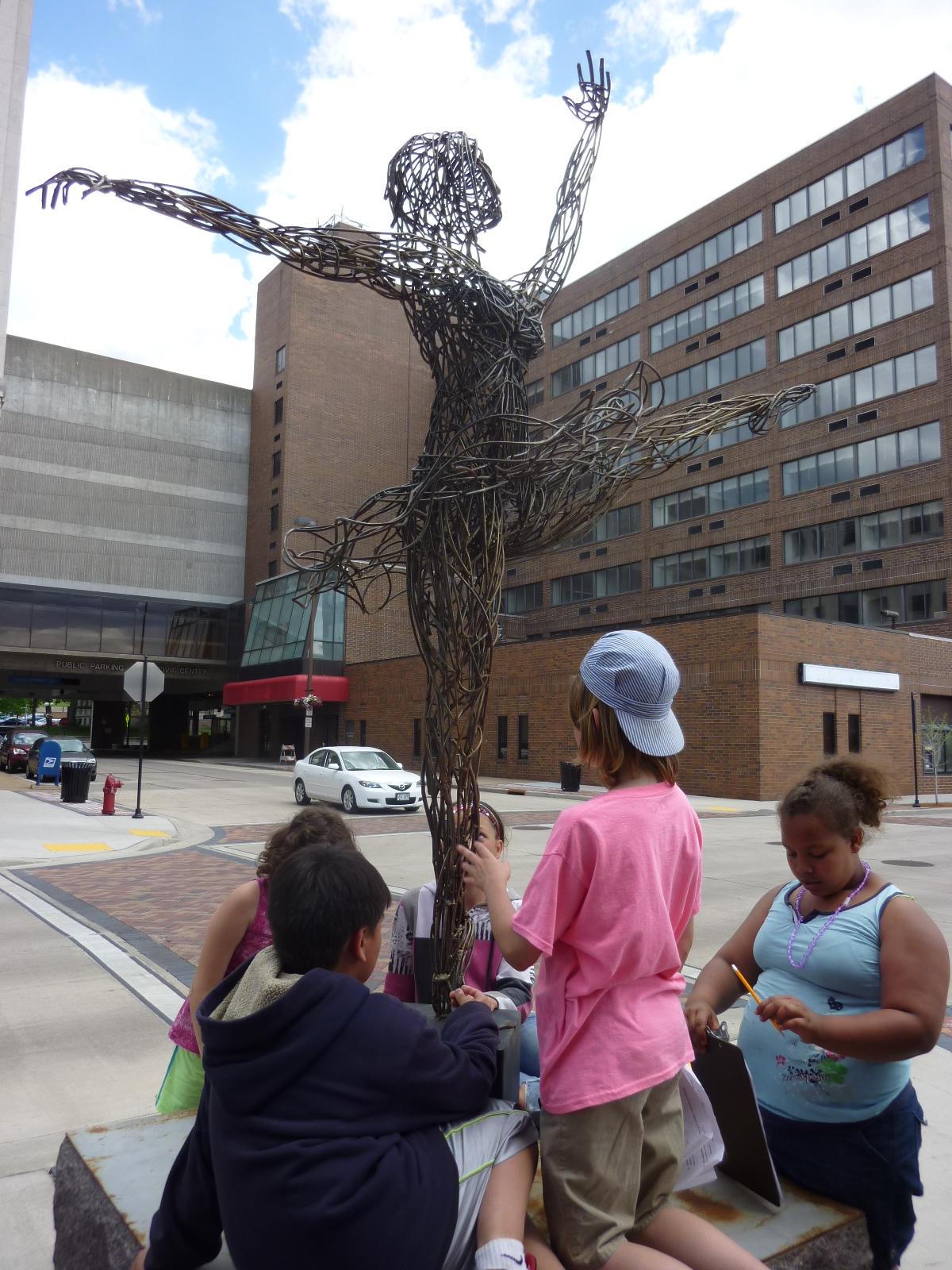 Children with dancer sculpture