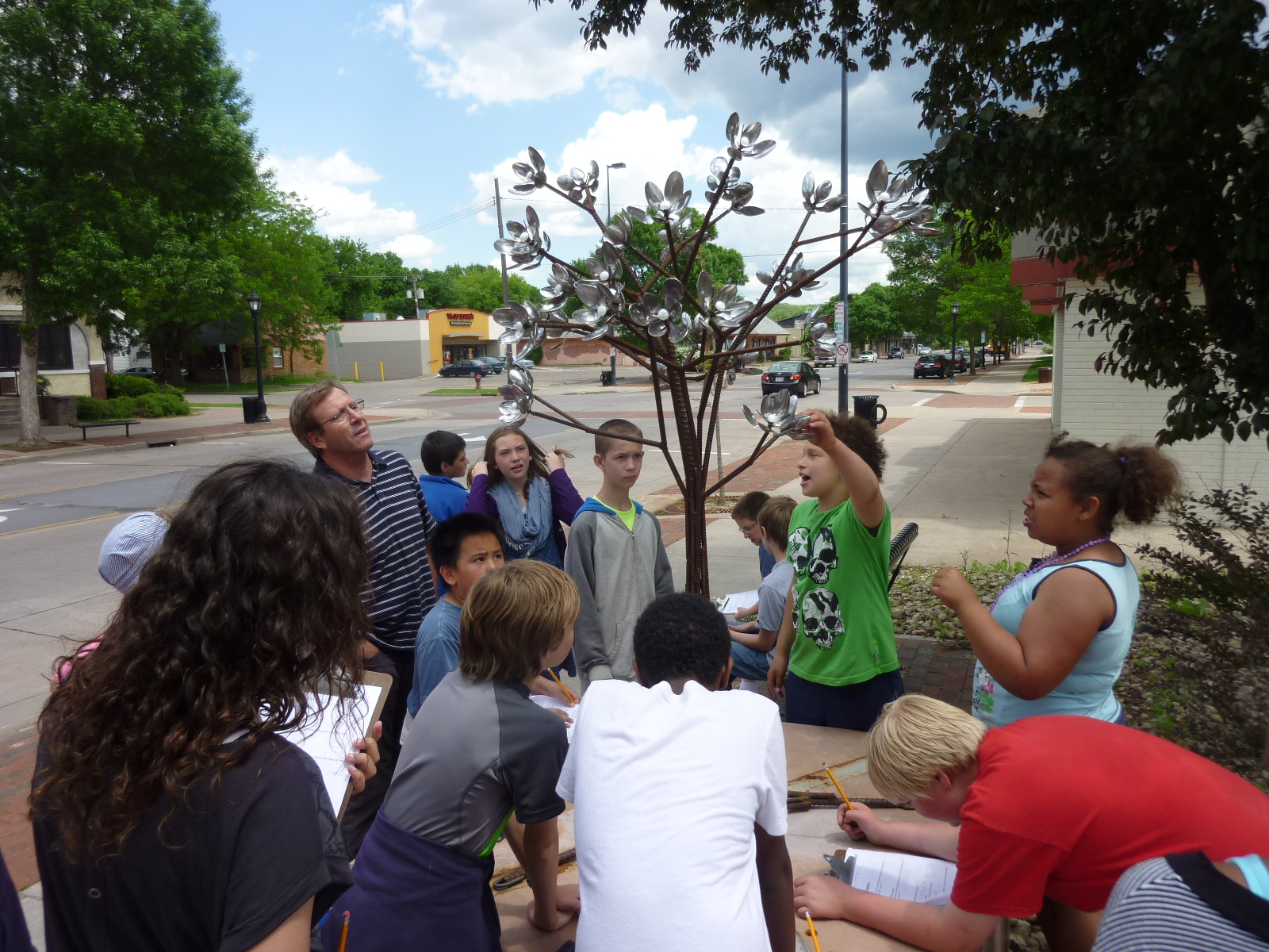 Children with tree sculpture