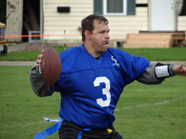 Man wearing a number 3 jersey throws a football