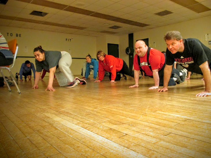 A group of people doing exercises on the floor
