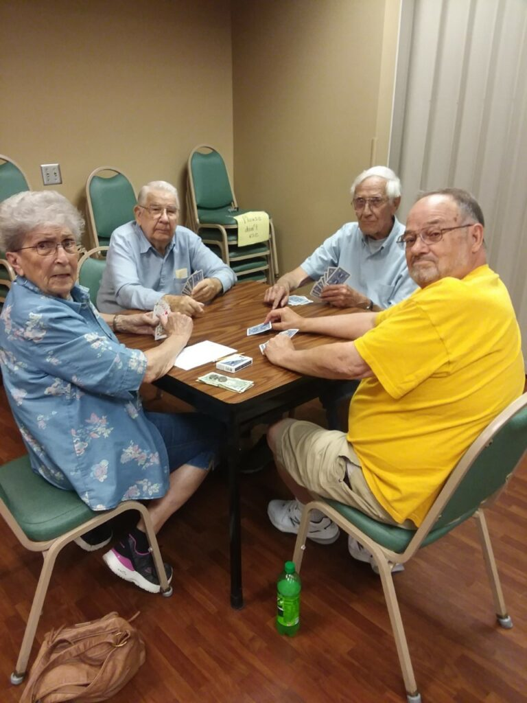Four people playing cards